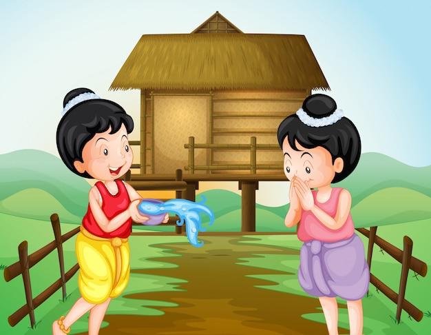 Zwei thailändische mädchen am wasserfestivaltag