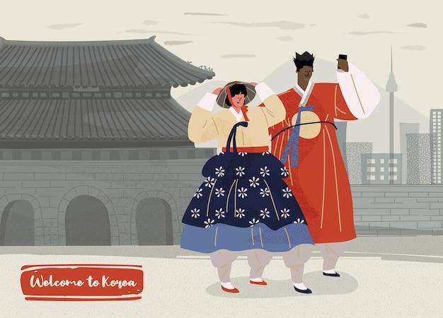 Zwei touristen machen selfies vor dem hintergrund des wunderschönen seoul