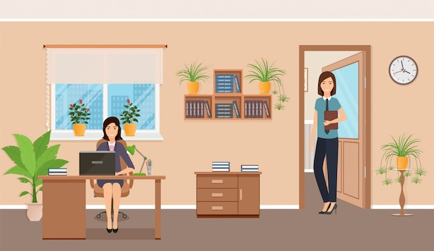 Zwei weibliche büroangestellte am arbeitsplatz am tisch mit laptop.