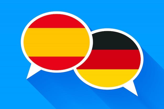 Zwei weiße sprechblasen mit spanien und deutschen flaggen.
