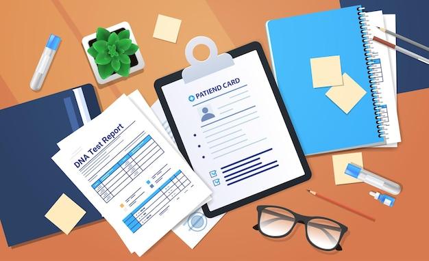 Zwischenablagen dokumente ordner mit genetischen dna-tests und berichte über medizinische behandlungsforschung und -tests in der klinik