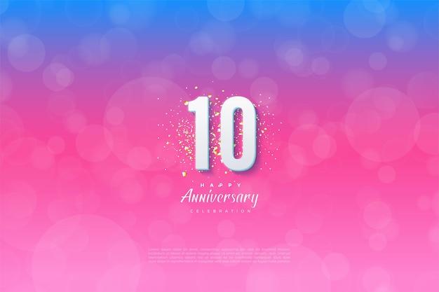 10º aniversário com números em fundo graduado em azul e rosa
