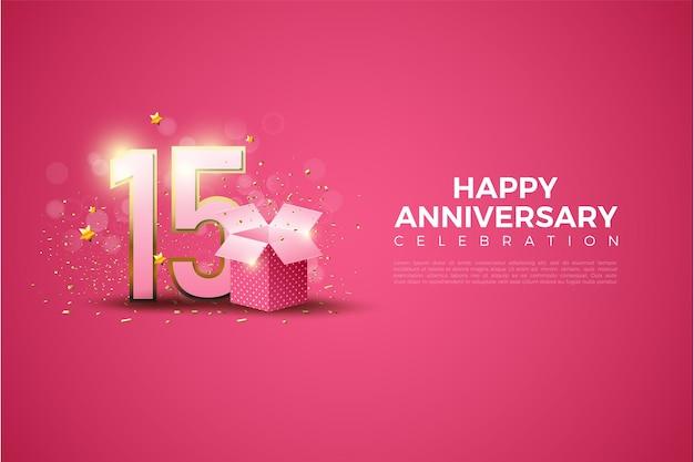 15º anivversário com caixa de presente na frente dos números em fundo rosa.