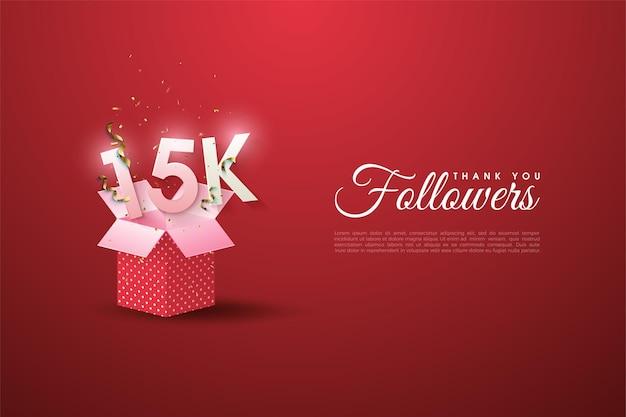 15k seguidores com números em cima de caixas de presente rosa.