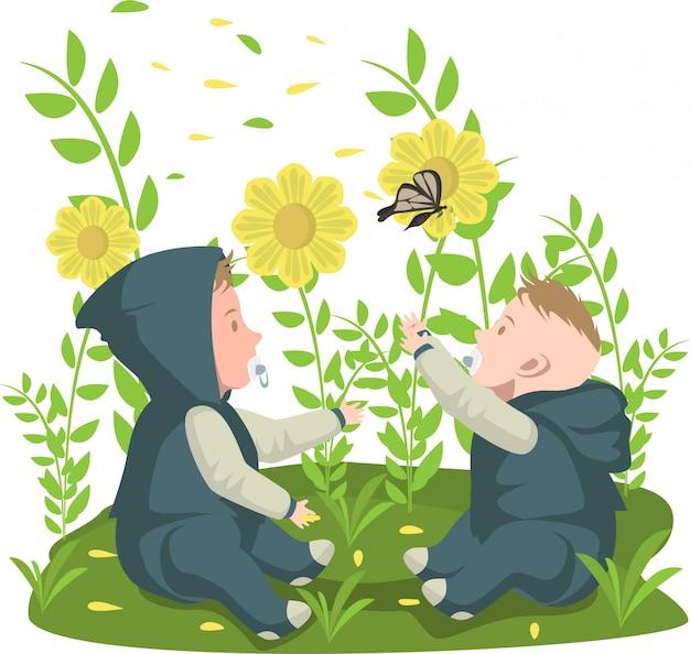 2 bebês brincando com uma borboleta no jardim