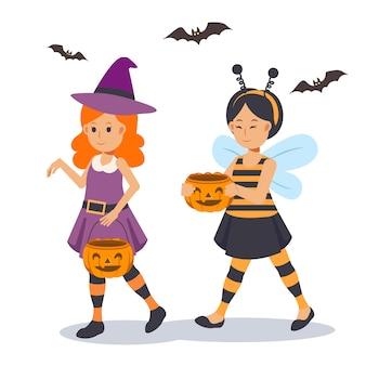 2 garotinhas fofas em fantasia de halloween são apreciadas. doçura ou travessura. bruxa bonita, abelha.