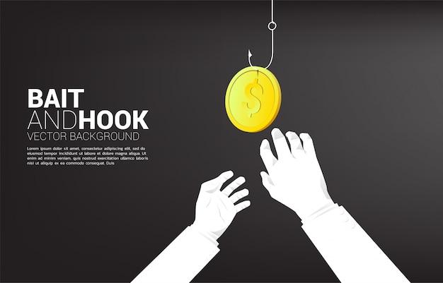 2 mão chegar a moeda dinheiro com anzol. conceito de isca e gancho no negócio.