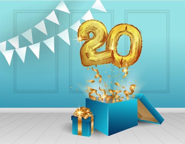20 anos de balões dourados. a celebração do aniversário. balões com confetes cintilantes saem voando da caixa, número 20 contra a parede.