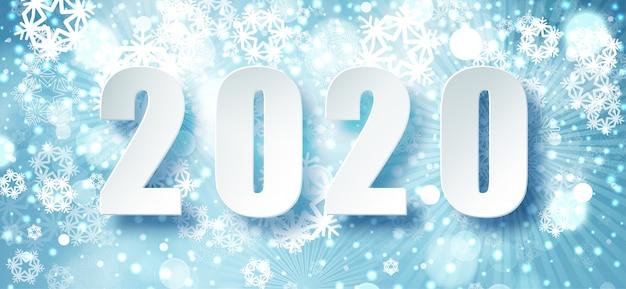 2020 tipografia de natal azul. fundo de temporada de inverno com queda de neve. modelo de cartaz de natal e ano novo. saudações de férias. .