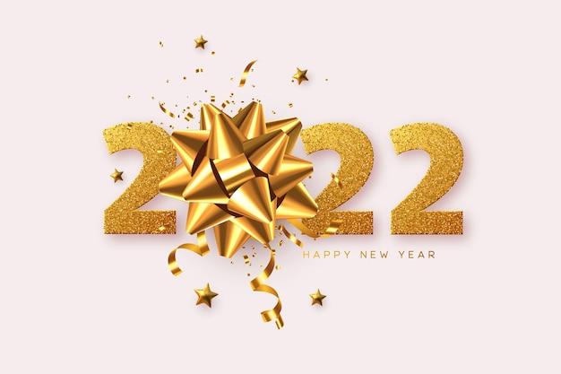 2022 feliz ano novo. laço dourado 3d com enfeites, estrelas e números de glitter em branco