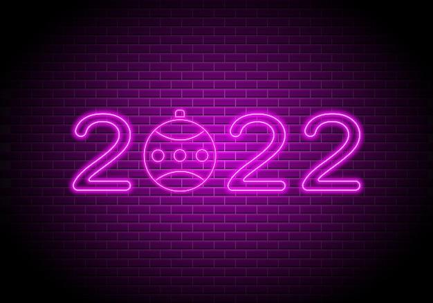 2022 números de néon sinal luminoso de ano novo no fundo da parede de tijolos