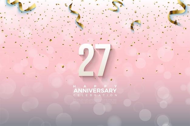 27º aniversário com fita dourada e ilustração de números.