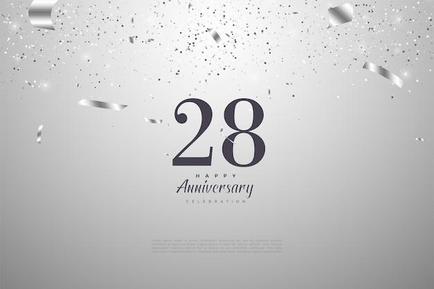 28º aniversário com números em fundo prateado