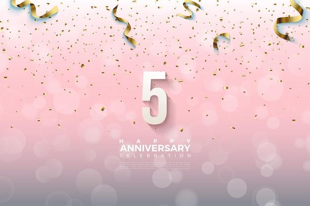 5º aniversário com o número caindo com uma fita dourada.