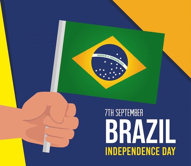 7 de setembro, celebração do dia da independência do brasil e mão com bandeira