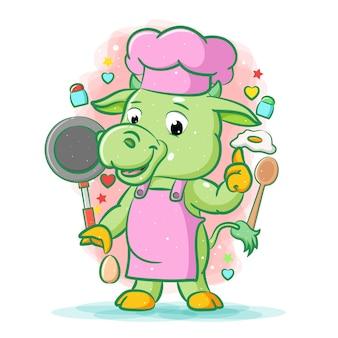 A animação da vaca verde com avental rosa em pé perto do conjunto de cozinha