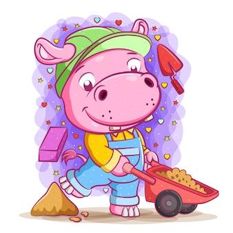 A animação do hipopótamo construtor puxa a areia no carrinho de mão