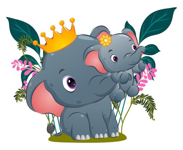 A bela rainha do elefante está levantando seu bebê com sua tromba no jardim da ilustração