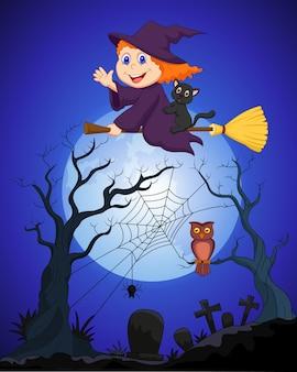 A bruxa voando em uma vassoura na lua cheia sobre o cemitério