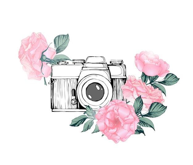 A câmera fotográfica retro vintage em flores deixa ramos em fundo branco.