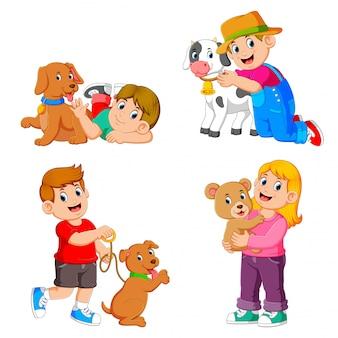 A coleção das crianças brincando com seus animais de estimação e animais