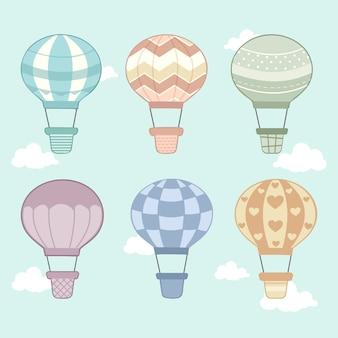 A coleção de balão de ar quente em qualquer estilo no céu e nas nuvens