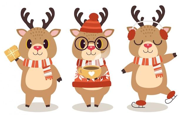 A coleção de cervos bonitos no tema de natal em branco.