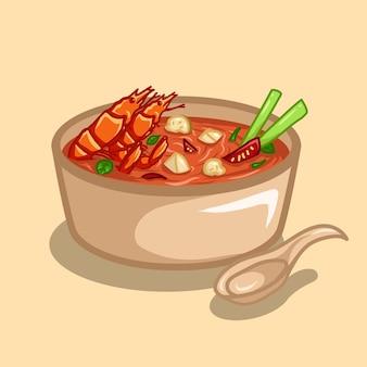 A comida tradicional tailandesa é a sopa tom yum com frutos do mar em uma tigela e uma colher.