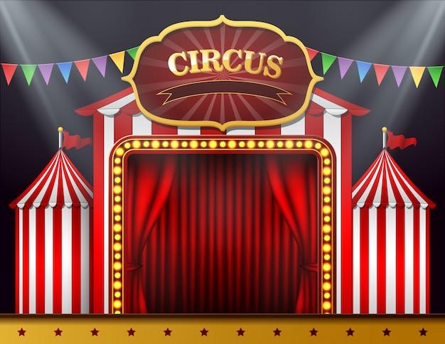 A entrada do circo com uma cortina vermelha fechada