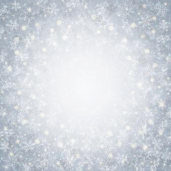 A época de inverno do natal com flocos de neve modela o fundo do círculo.