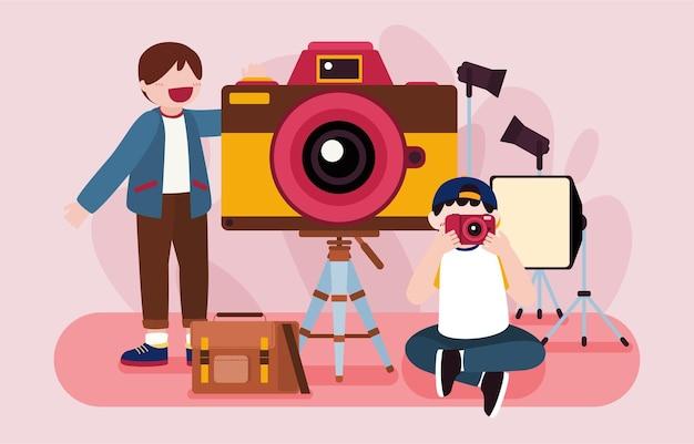 A equipe de jovens fotógrafos usa câmera e iluminação, flash e tripé no estúdio para tirar fotos