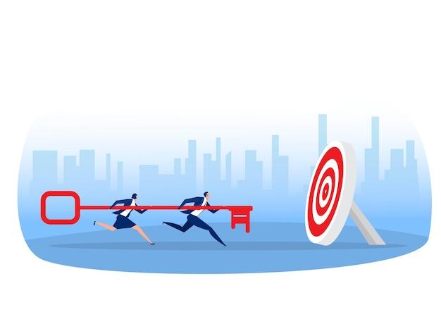A equipe de negócios carrega uma grande chave para o conceito de objetivo