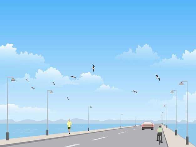 A estrada à beira-mar tem o mar e o céu como pano de fundo.
