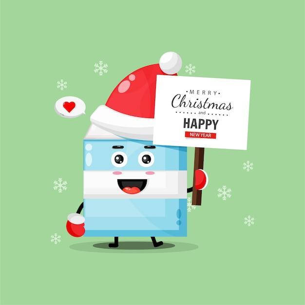 A fofa mascote do leite traz um quadro de felicitações de natal