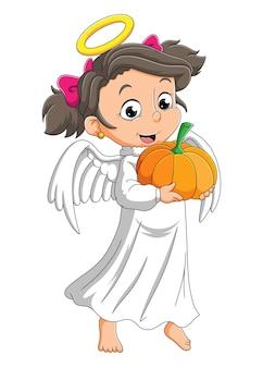 A garota com a fantasia de anjo está segurando a abóbora da ilustração