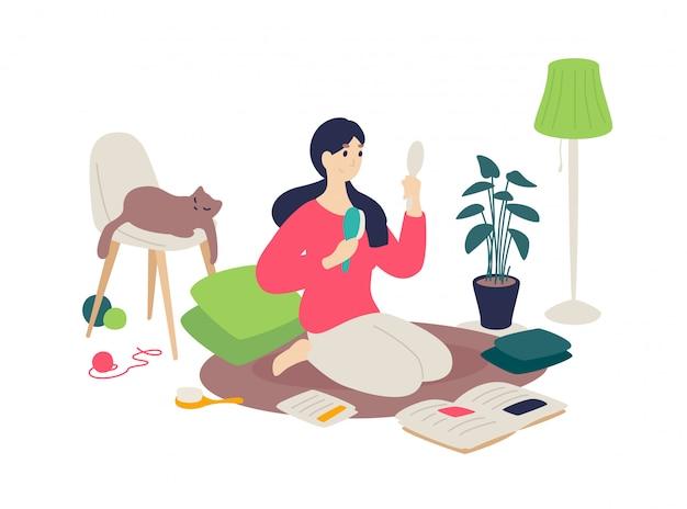 A garota está penteando o cabelo com um pincel. uma mulher está envolvida em si mesma, lendo revistas.