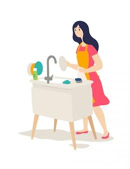 A garota lava a louça. o guardião do lar faz trabalhos domésticos.