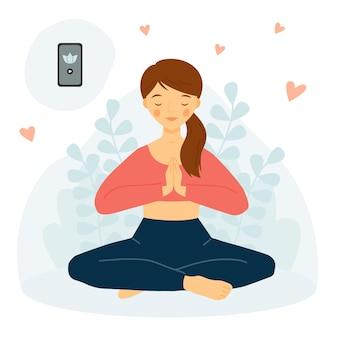 A garota pratica ioga com o telefone conceito de meditação yoga mobile app garota em pose de lótus