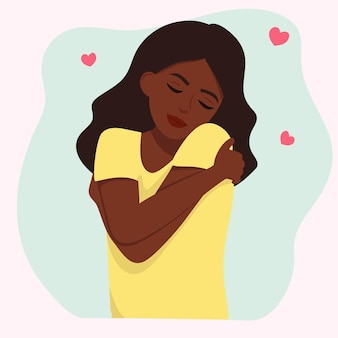 A garota se abraça. ame a si mesmo.