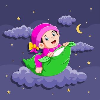 A ilustração da menina está usando a roupa de dormir e segurando o travesseiro