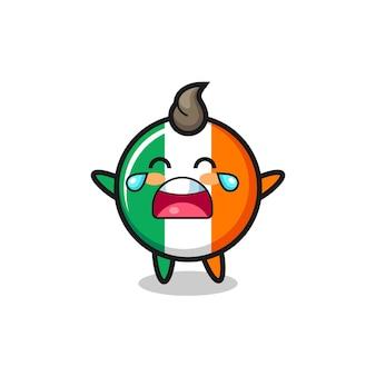A ilustração de chorar bebê fofo com o emblema da bandeira da irlanda, design de estilo fofo para camiseta, adesivo, elemento de logotipo