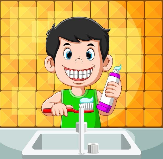A ilustração do menino está sorrindo e escovando o rosto com a pasta de dente