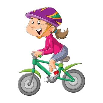 A jovem está pedalando com a bicicleta da ilustração