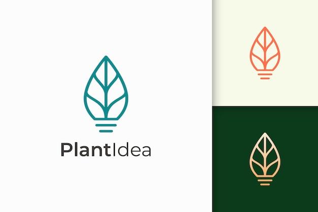 A lâmpada e o logotipo da folha em moderno representam inovação e inspiração