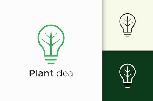 A lâmpada e o logotipo da folha em um estilo simples e moderno representam a ideia de tecnologia