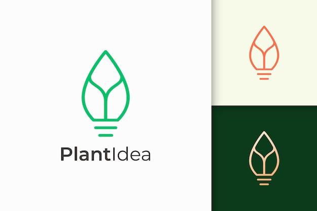 A lâmpada e o logotipo da folha em um estilo simples e moderno representam uma ideia nova