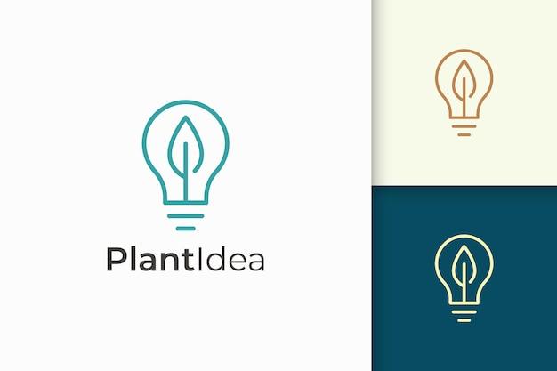 A lâmpada e o logotipo da folha em um estilo simples representam energia e inovação