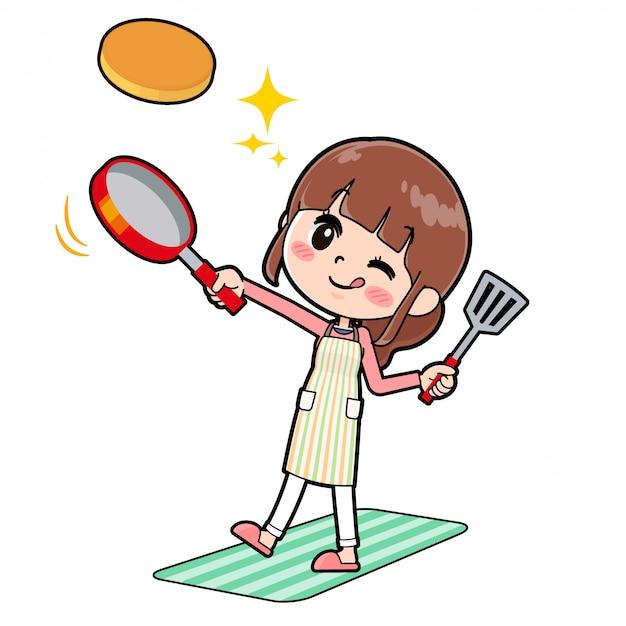 A linha avental da mãe cozinhe o hotcake