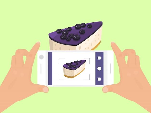 A mão com telefone tira a foto da ilustração do alimento do bolo. fotografia de smartphone de torta. vista superior da foto de telefones de bolos.
