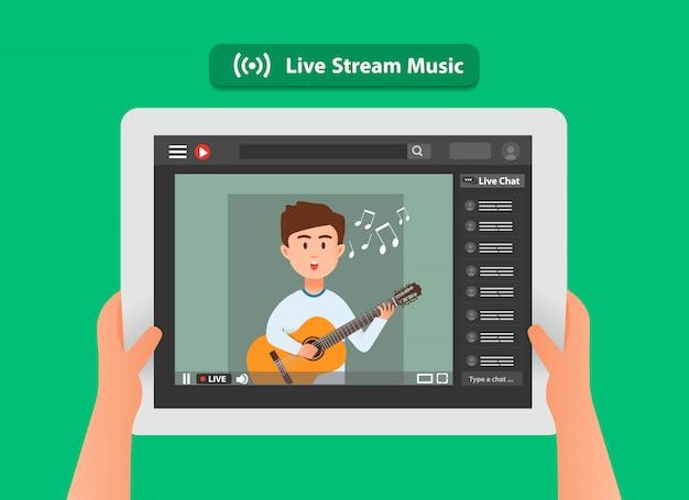 A mão de alguém segurando um tablet e assistindo música ao vivo on-line